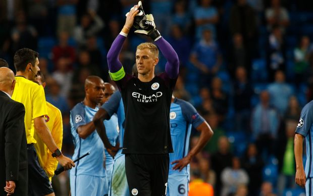 Manchester City goalkeeper Joe Hart applauds the crowd following his side's win in the Champions League.