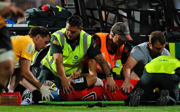 The Crusaders' Reed Prinsep is treated after suffering a concussion