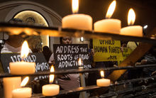 Human rights advocates hold placards condemning extra judicial killing after a mass at the Redemptorist Church in Manila on 10 August 2016.