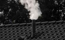Chimney with smoke coming out of it.