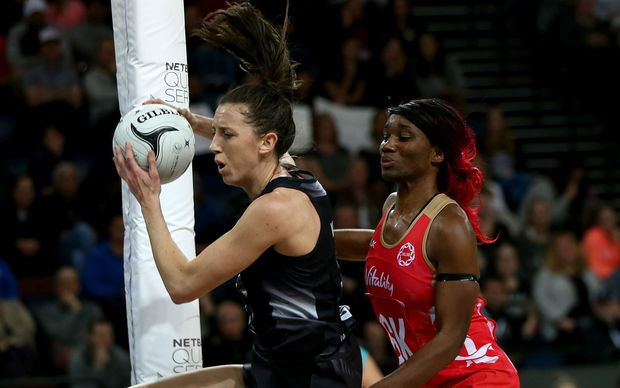 Bailey Mes is challenged by England`s Captain Ama Agbeze.