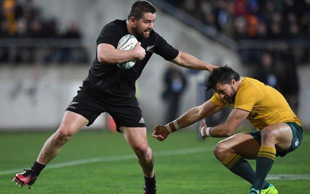Dane Coles sees off Adam Ashley Cooper.