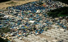"An aerial view of the ""jungle"" camp at Calais where NGOs estimate more than 9000 migrants live."