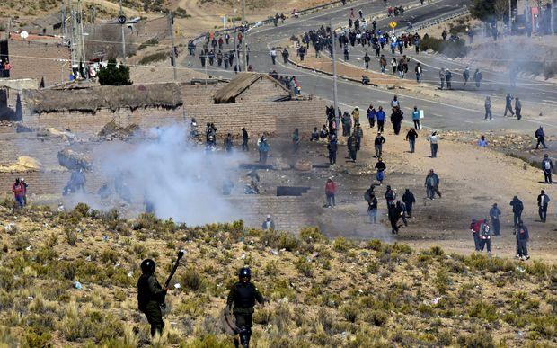 Riot policemen and miners clash in Panduro, in the La Paz district of Bolivia.