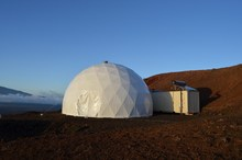 The team has almost no privacy, living in this small domed structure for a year.
