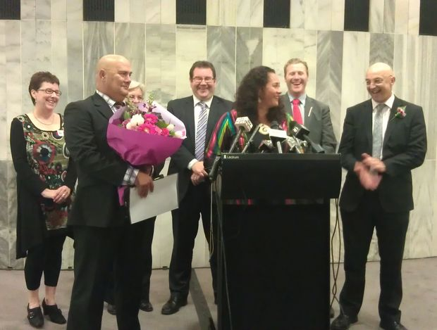 Labour's Louisa Wall (at podium) with supporting MPs after the vote on Wednesday.