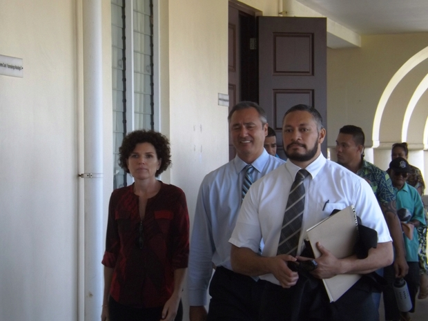Police Commissioner, Fuiavailili Egon Keil, in the middle heading to court with his lawyer (right) a family supporter and civilian police officers behind.
