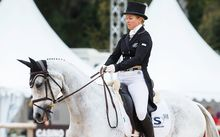 Jonelle Price sits in sixth place after her opening dressage session at Burghley.