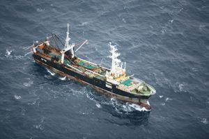 The trawler hit rocks and ruptured a fuel tank.
