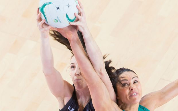 Silver Ferns shooter Bailey Mes battles for the ball against Australian Sharni Layton 2016.