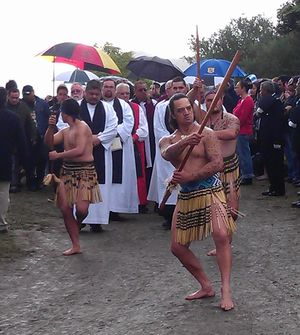 The funeral procession leaves the marae.