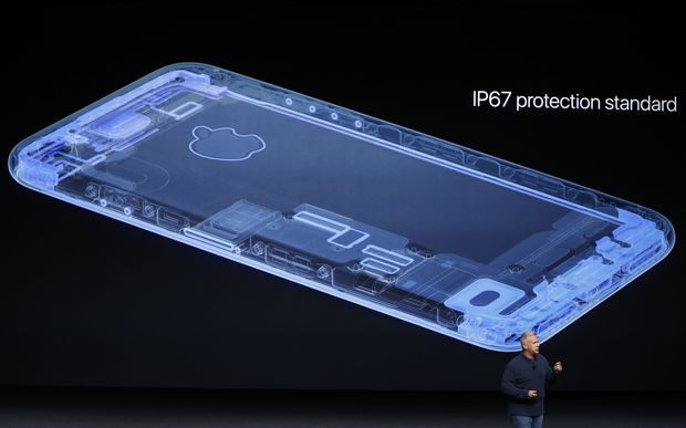 Apple senior vice president of worldwide marketing Phil Schiller unveils the new Apple iPhone 7 during a launch event in San Francisco, California.