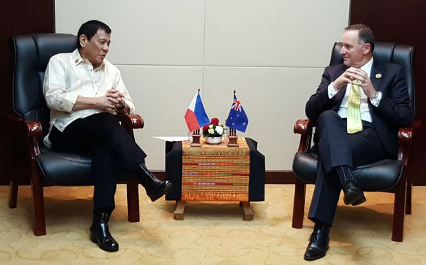 NZ Prime Minister John Key (right) meets with Philippine president Rodrigo Duterte at the East Asia Summit.
