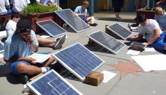 Students from Trident High School testing their photo voltaic water heating systems