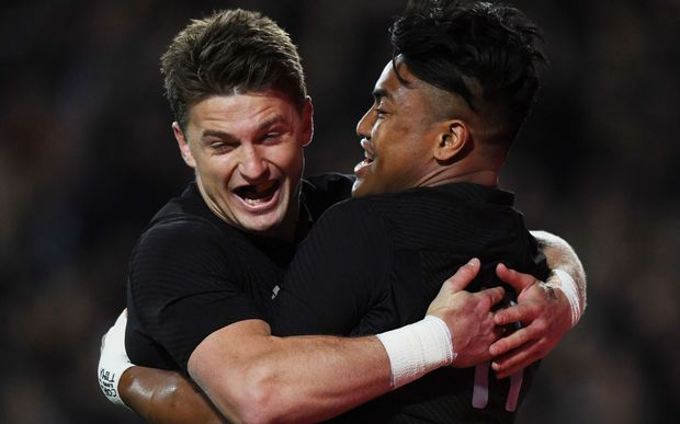 Julian Savea scores a try and celebrates with Beauden Barrett.