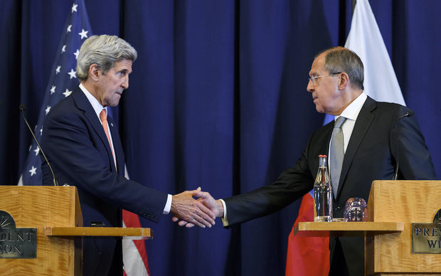 US Secretary of State John Kerry and Russian Foreign Minister Sergei Lavrov shake hands on a truce deal for Syria.