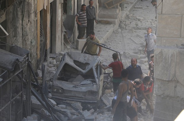 Aleppo residents search through debris after further air strikes on the city.
