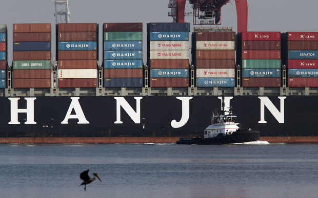 A Hanjin container ship docks at Long Beach, California, after a week stranded at sea for fear it could be seized by creditors.