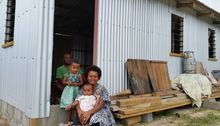 Maraia Waqa with her family and new home.