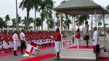 Fiji President Jioje Konrote salutes military as they play the national anthem.