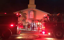 In this image obtained from the St. Lucie County Sheriff's Office, firefighters put out a blaze at the Islamic Center of Fort Pierce in Florida on 12 September.