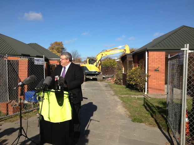 Gerry Brownlee in the quake-affected suburb of Burwood on Wednesday.