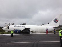 The Trigana 737 aircraft skidded for a kilometre on its belly along the runway before coming to rest to the side of the strip.