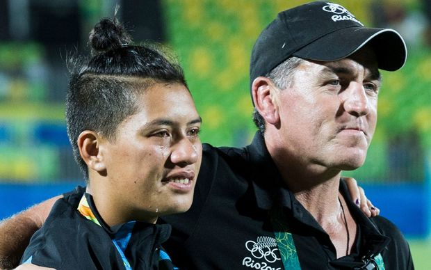 New Zealand coach Sean Horan comforts Gayle Broughton after the loss against Australia in the Women's Sevens Gold medal final, Rio Olympics.