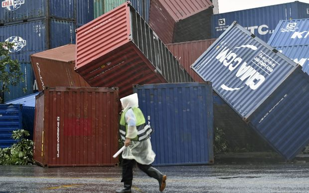 A man walks past downed shipping containers at the Kaohsiung Harbour as typhoon Meranti lashed southern Taiwan.