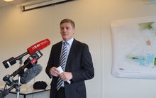 The Minister Responsible for Housing New Zealand, Bill English, makes the announcement in front of plans for the new housing.