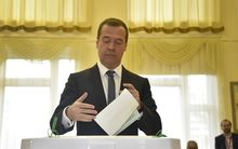 Russian Prime Minister Dmitry Medvedev prepares to cast his ballot for Russia's parliamentary election.