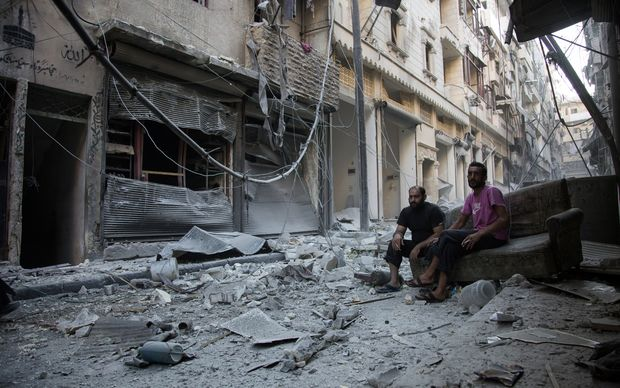Aleppo's rebel-controlled neighbourhood of Karm al-Jabal on 18 September following an air strike.