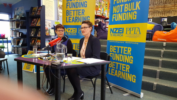 NZEI president Louise Green and PPTA president Angela Roberts announce the results of a vote in which teachers overwhelmingly opposed a proposed change to school funding.