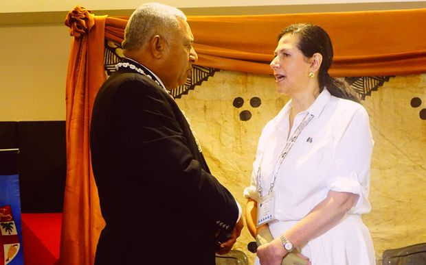 Fiji's Prime Minister with Australia's Pacific Minister Concetta Fierravanti-Wells. She says new buildings will be built to Category 5 standard.