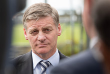 Bill English at a social housing announcement in Northcote