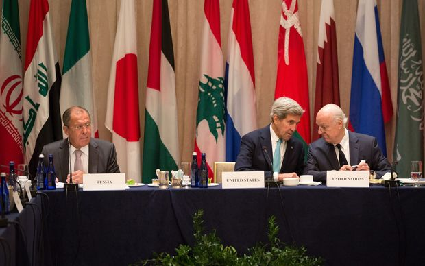 US Secretary of State John Kerry, centre, Staffan de Mistura, UN special envoy for Syria, right, and Russian Minister of Foreign Affairs Sergei Lavrov attend the International Syria Support Group meeting.