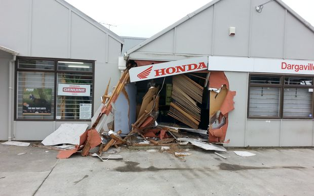 The early morning smash left a gaping hole in the motorcycle dealership building.