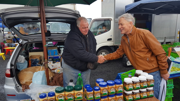 Phil Goff greets locals at the Avondale market.
