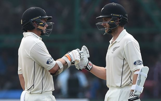 New Zealand's captain Kane Williamson (R) congratulates Tom Latham after his half century during the second day of the first Test match between India and New Zealand at Green Park Stadium in Kanpur on September 23, 2016.