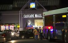 Police attend the Cascade Mall after three women were reportedly shot dead and a man critically injured following a shooting at the shopping center