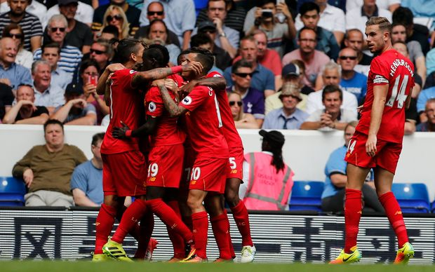 Liverpool players celebrate a goal in the EPL.