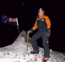 Mike Rowe on Crater Hill in Antarctica with the axe signed by Sir Edmund Hillary.