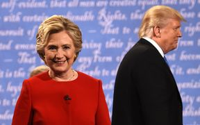 Hillary Clinton and Donald Trump leave the stage after the first presidential debate.