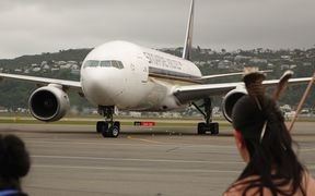 A Singapore Airlines flight arrives at Wellington Airport.