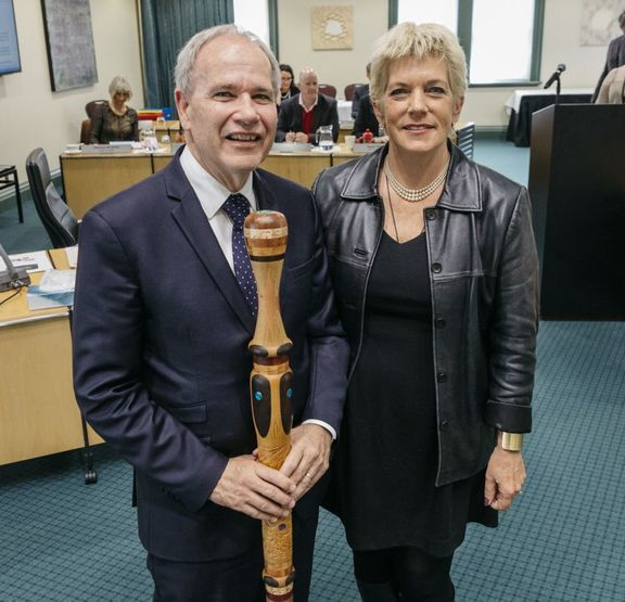 Len brown with Penny Hulse at his final Auckland council meeting as mayor.