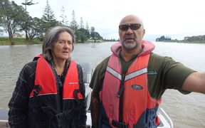 Green MP Cathrine Delahunty and Friends of the Waitara member Robbie Taylor discuss pollution issues in the river.