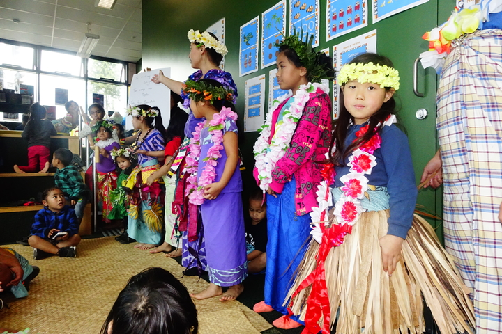 Children prepare a Tuvaluan song to perform.