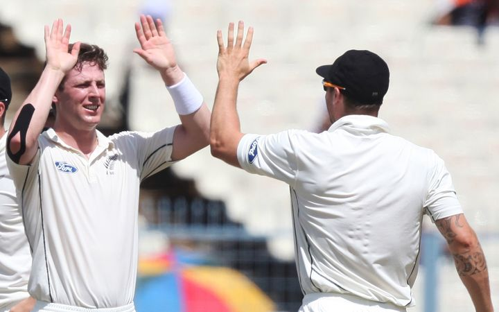 Matt Henry celebrates taking a wicket.