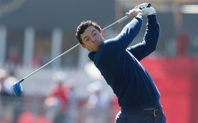 Rory McIlroy tees off on the 18th hole during the Day 1 morning matches for the 2016 Ryder Cup.