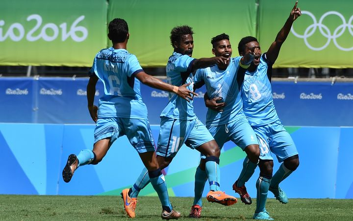 Roy Krishna (2nd R) and teammates celebrate his goal against Mexico at the Rio Olympics.